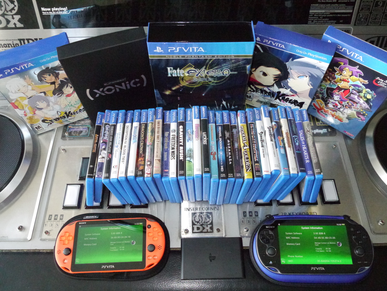Finished Vita 1000, 2000, and TV displayed with physical Vita game library