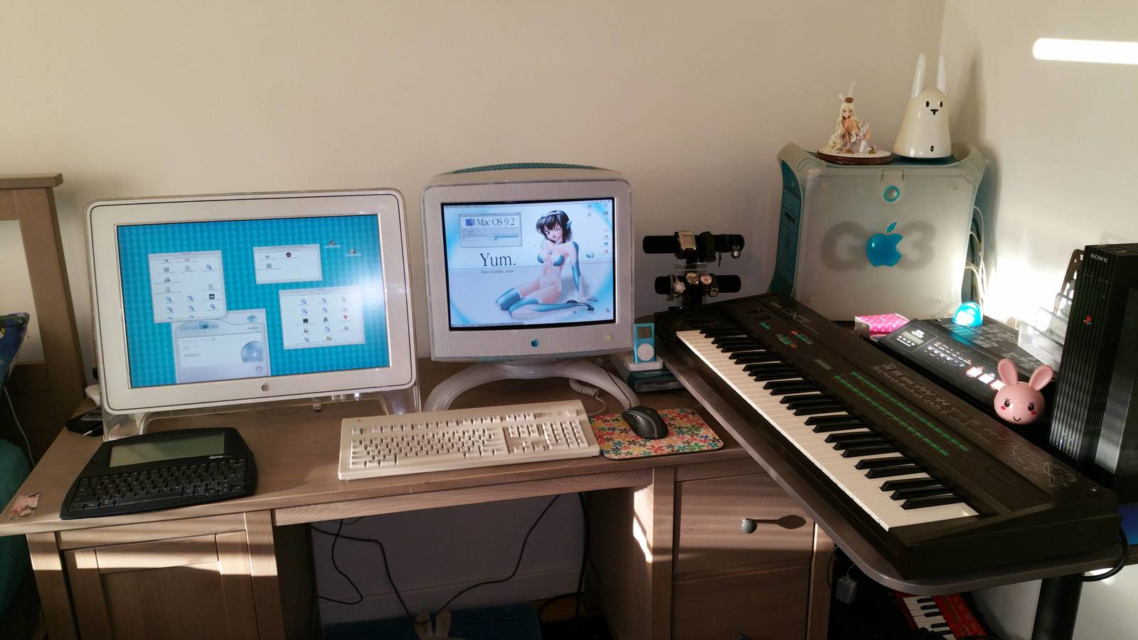 Blue & White Power Macintosh G3 on a desk with two monitors, Extended II keyboard, and Yamaha DX7