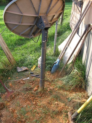 The same antenna installed behind a home with cables trenched in.