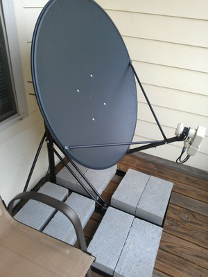 My 1 meter satellite dish on a non-penetrating mount on my deck.