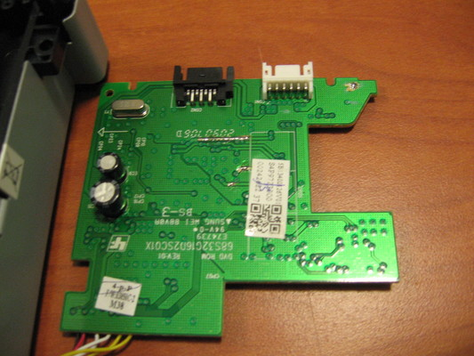 The PCB post-flash with the cut traces repaired with solder and wire.