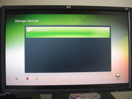 Xbox 360 dashboard showing unformatted hard drive.