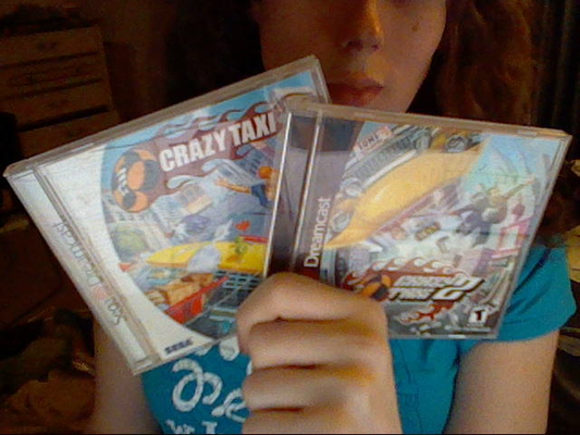 My holding Crazy Taxi and Crazy Taxi 2 for Dresmcast.