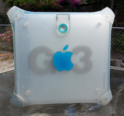 Side photograph of my Blue & White G3 tower on an outdoor glass table.