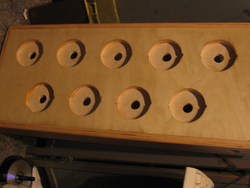 Holes drilled in two-layer wooden controller body.