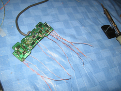 Wire leads attached to bare circuit board from a Sony digital control pad.