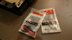 Radio Shack fuse holder and bag of fuses.