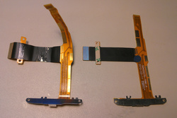 The old and new slider ribbon cables next to each other with the old one visibly damaged.
