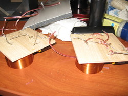 Constructing crossover circuits on two pieces of scrap wood.