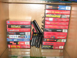 My Mega Drive game library stacked on a shelf.