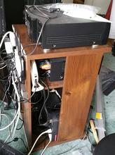 Wooden audio cabinet holding network and AV equipment